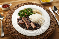 Feijoada. Brazilian feijoada dish on rustic table stock photo