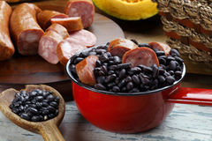 Feijoada. Brazilian feijoada with pepperoni sausage royalty free stock images