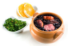 Feijoada, Brazilian traditional meal. Typical food of Brazil, made with black beans and pork Royalty Free Stock Photos