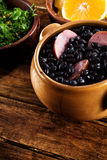 Feijoada, Brazilian traditional meal. Typical food of Brazil, made with black beans and pork Royalty Free Stock Image