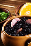 Feijoada, Brazilian traditional meal. Typical food of Brazil, made with black beans and pork Royalty Free Stock Images