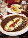 Feijoada with chili steak. A chili steack with a lot of black beans and cheese Stock Photo