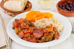 Feijoada with rice and orange. On the plate stock photo