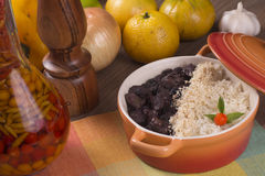 Feijoada. Traditional feijoada brazileira with rice, farofa and orange royalty free stock images