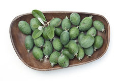 Feijoas in wooden bowl. Isolated on white royalty free stock images