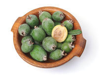 Feijoas in wooden bowl. Isolated over white Stock Images