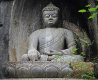 Feilai Feng grottoes with fine buddhist stone carvings Royalty Free Stock Photos