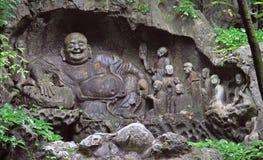 Feilai Feng grottor med fina buddistiska stencarvings Arkivfoton