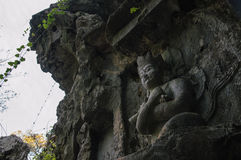 Feilai Feng stone carvings, Lingyin temple. Feilai Feng grottoes with fine buddhist stone carvings. It is called 'the Peak that Flew Hither or Flying Peak and is stock image