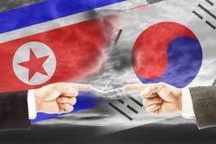 Feindschaft und Antagonismus zwischen Nord- und Südkorea Lizenzfreies Stockbild