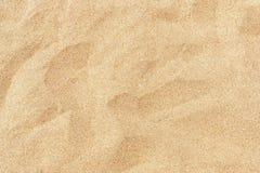 Feiner Strandsand in der Sommersonne Lizenzfreies Stockfoto