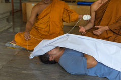 Feint requiem is a ceremony for protect to dead. Bangkok, Thailand - June 19, 2016 : Feint requiem is a ceremony for protect to dead. Use shroud cover on a man Stock Photos