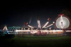 Feira de divertimento na noite Fotografia de Stock