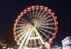 A feira de divertimento roda dentro o movimento Fotografia de Stock
