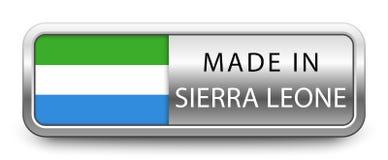 FEITO no crachá metálico de SERRA LEOA com a bandeira nacional isolada no fundo branco ilustração stock