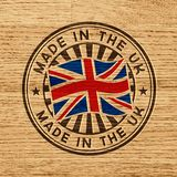 Feito no Reino Unido Selo no fundo de madeira Imagem de Stock Royalty Free
