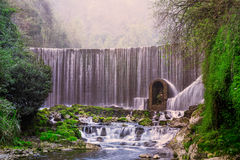 Feiyun waterfall in Zhangjiang Scenic Spot,Libo,China. This picture shows the Feiyun waterfall landscape in Zhangjiang Scenic Spot,Libo,China .Libo Zhangjiang Stock Images