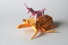 Fel för origami för origamienhörningridning Fotografering för Bildbyråer