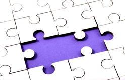 felande stycken två för jigsaw Royaltyfria Bilder