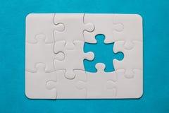 felande styckpussel för jigsaw royaltyfria foton