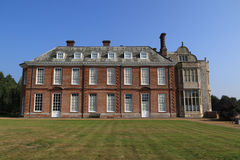 Felbrigg Hall from the lawn. Felbrigg Hall is a 17th-century country house located in Felbrigg, Norfolk, England. Part of a National Trust property, the royalty free stock images