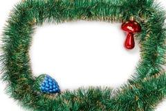 Feld der grünen Weihnachtsgirlande mit Weihnachten spielt Lizenzfreie Stockbilder