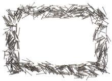 Feld der Nägel auf weißem Hintergrund Lizenzfreies Stockfoto