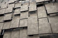 Feld von braunen quadratischen Platten mit Steinbeschaffenheit Stockfotos