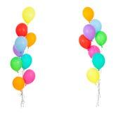 Feld von den bunten Ballonen getrennt auf Weiß Stockfotografie