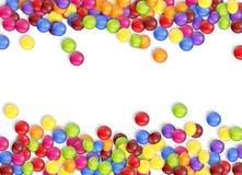 Feld von Süßigkeiten mit einem weißen Hintergrund Lizenzfreies Stockfoto