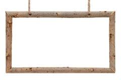 Feld von trockenen Baumasten mit Seil Stockbild