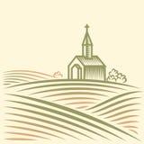 Felder und Kirche Stockbilder
