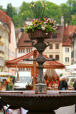 Feldkirch,Austria. Flower fountain decorate main square in Feldkirch,colorful old building as background.Austria Royalty Free Stock Photos