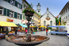 Feldkirch,Austria. Main square in Feldkirch,Flower fountain with colorful old building as background.Austria Stock Photo