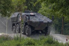 German armoured medical carrier Boxer. FELDKIRCHEN / GERMANY - JUNE 9, 2018: German armoured medical carrier Boxer, from Bundeswehr, drives on a road at Day of Stock Photography