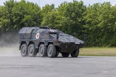 German armoured medical carrier Boxer. FELDKIRCHEN / GERMANY - JUNE 9, 2018: German armoured medical carrier Boxer, from Bundeswehr, drives on a road at Day of Stock Photos