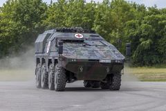 German armoured medical carrier Boxer. FELDKIRCHEN / GERMANY - JUNE 9, 2018: German armoured medical carrier Boxer, from Bundeswehr, drives on a road at Day of Royalty Free Stock Image