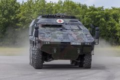 German armoured medical carrier Boxer. FELDKIRCHEN / GERMANY - JUNE 9, 2018: German armoured medical carrier Boxer, from Bundeswehr, drives on a road at Day of Stock Image