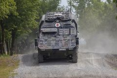German armoured medical carrier Boxer. FELDKIRCHEN / GERMANY - JUNE 9, 2018: German armoured medical carrier Boxer, from Bundeswehr, drives on a road at Day of Royalty Free Stock Images