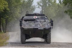 German armoured medical carrier Boxer. FELDKIRCHEN / GERMANY - JUNE 9, 2018: German armoured medical carrier Boxer, from Bundeswehr, drives on a road at Day of Stock Photo