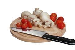 Feldpilze und -tomaten Stockfoto