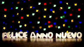 Felice anno nuevo, happy new year in Italian language. Text, beautiful multicolor bokeh background with copy space Stock Photography