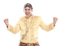 Felice di uso dell'uomo tradizionale di Java fotografia stock