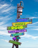 2016 Felices Año Nuevo escritas en francés en un postsign Imagen de archivo