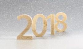 2018 Felices Año Nuevo, números cortaron de la madera ligera en un backg gris Foto de archivo