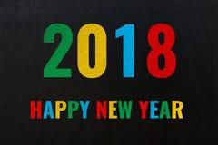 2018 Felices Año Nuevo, texto colorido de la tiza en la pizarra Foto de archivo