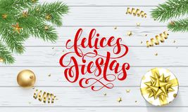 Felices Fiestas Navidad Spanish Happy Holidays golden decoration and calligraphy font for greeting card white wooden background. V. Ector Christmas or New Year Royalty Free Stock Photos
