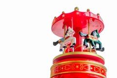 Felices rojos de la caja de música van el primer b blanco del juguete de los caballos del carrusel de la ronda Fotografía de archivo libre de regalías
