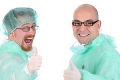 Felicidad de dos cirujanos imagen de archivo