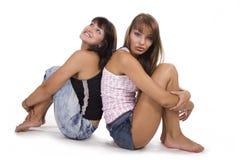 Felicidad de la muchacha del amigo de dos jóvenes Foto de archivo